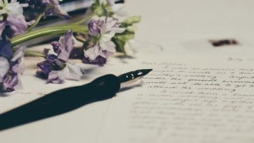 A thank you letter to ex boyfriend with a classic ink-pen and a bunch of flowers