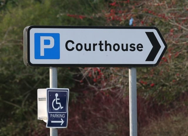 A roadside signboard indicates the way to the Courthouse of Coleraine Magistrates Court